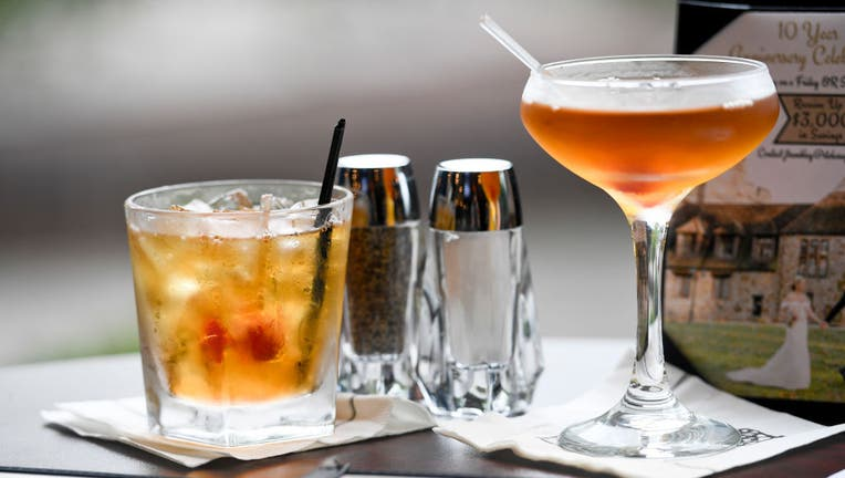 FILE - Alcoholic drinks are pictured on a table in a file image taken on Aug. 6, 2020, in Lower Alsace Township, Penn.