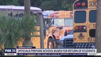 Officials prepare school buses for return of students