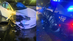 Dashboard camera video released of Tesla crashing into FHP patrol car
