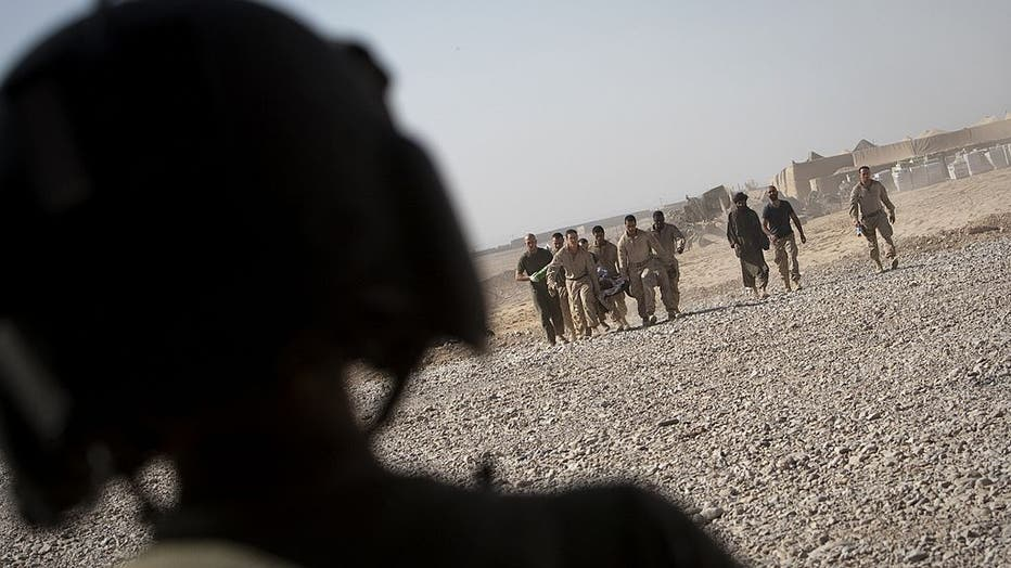 A US medevac personnel watches as US mar