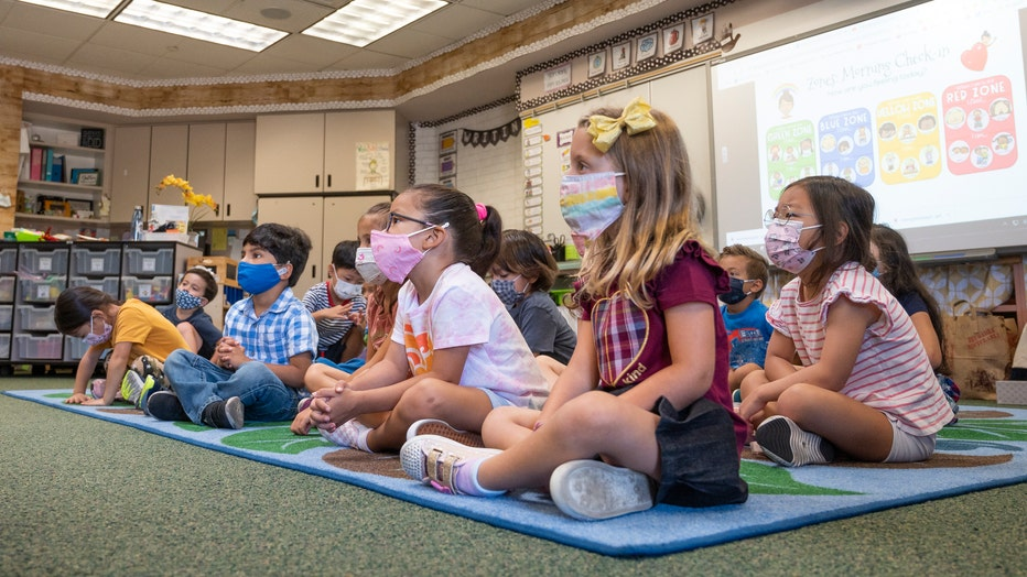 5a07561e-Elementary students return to class