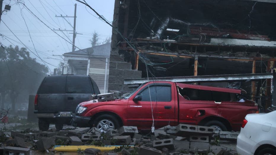 NEW ORLEANS, LOUISIANA - AUGUST 29: Vehicles are damaged after the front of a building collapsed during Hurricane Ida on August 29, 2021, in New Orleans, Louisiana. (Photo by Scott Olson/Getty Images)