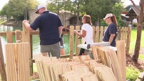 Volunteers donate time and skill to new fence at Give Kids the World