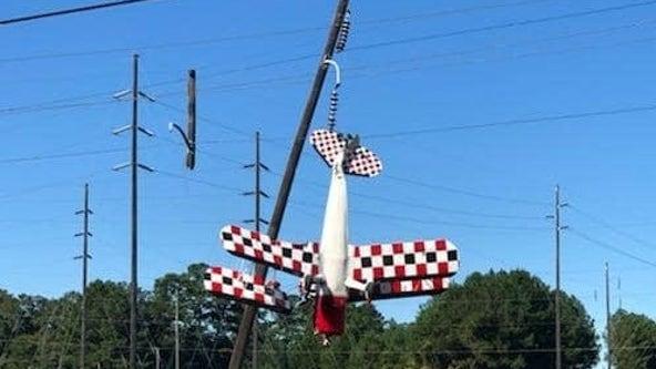 Florida pilot left dangling in power lines after plane crashes