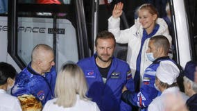 Russian film crew lands after shoot onboard space station