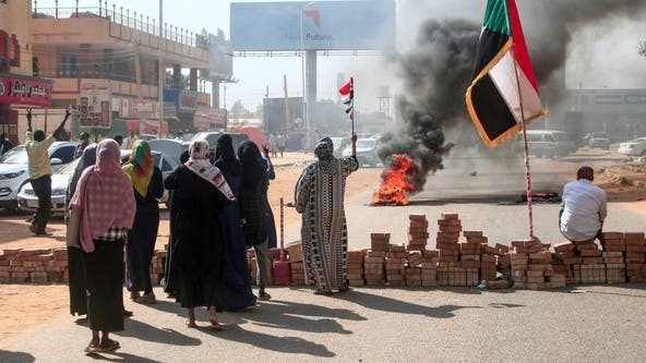 Sudan prime minister held in apparent coup; general declares emergency