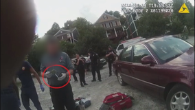 Body cam reveals officer stealing from murder victim
