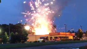 'Spectacular fire' destroys at least 2 containers at fireworks store