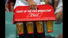 Angry World Cup fan throws beer in reporter's face during live broadcast