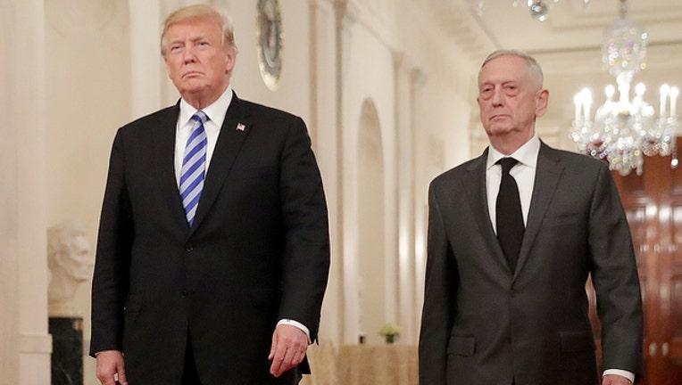 GETTY Mattis and Trump 122018-401720
