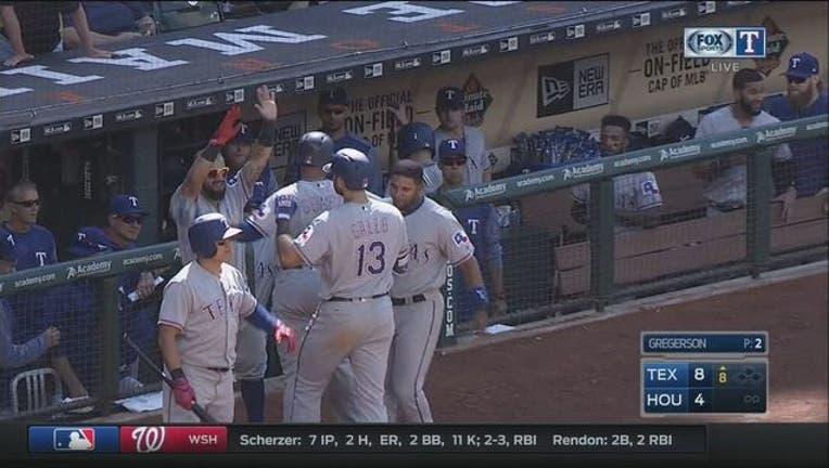 3f3d79d1-Rangers Beat Astros_1493939616603.jpg