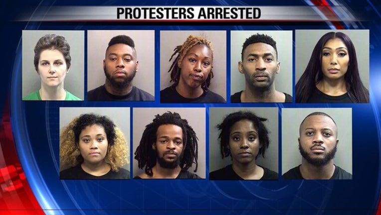 4ab4ac95-Dallas Nine cowboys stadium protesters arrested