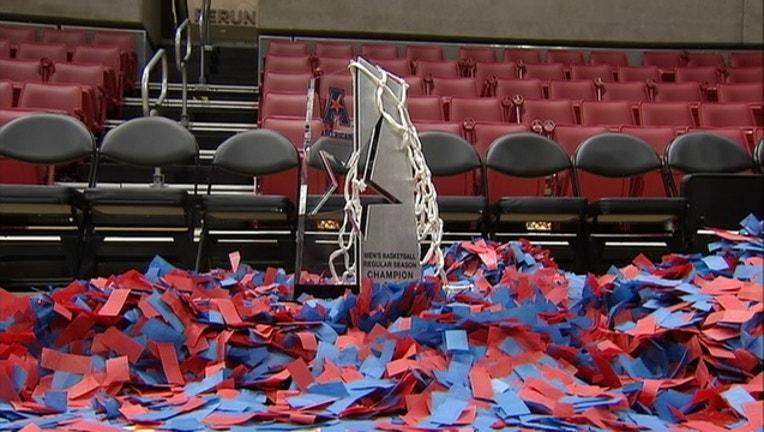 4b40030e-SMU basketball championship trophy AAC