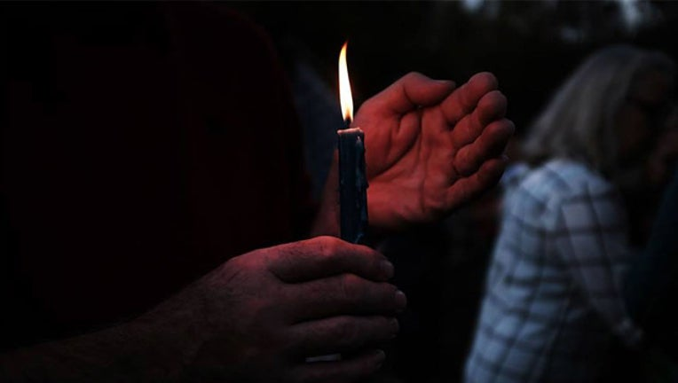GETTY candlelight vigil_1521838045953.jpg-407693.jpg