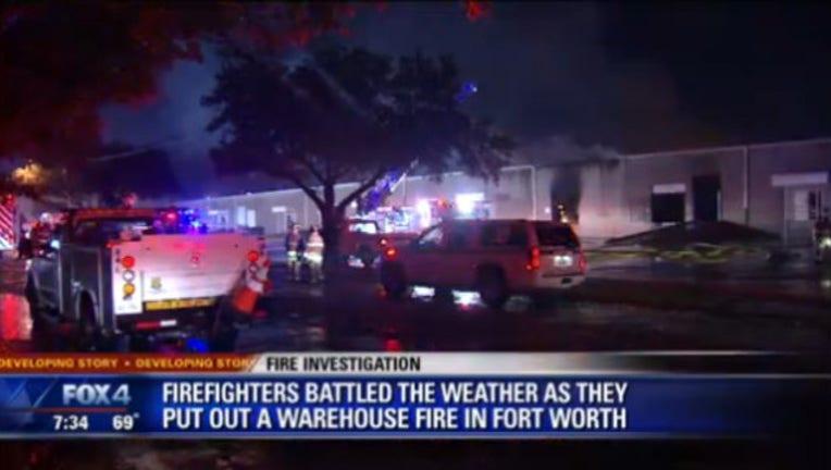 58df9c9d-warehouse fire_1496499556202.jpg