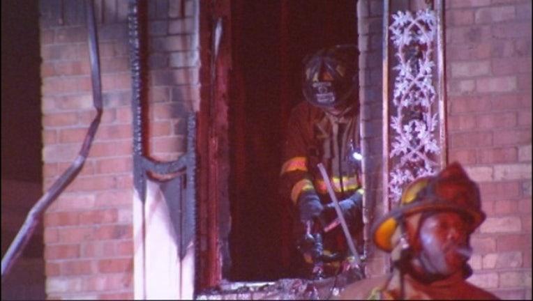 59c67ba2-Woman found dead after firefighters put on Dallas house fire_1543768281643.jpg.jpg
