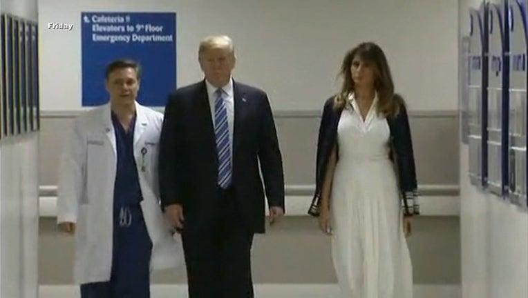7029c78c-TRUMP visits florida hospital shooting victims