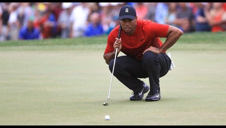 72c28f59-Tiger Woods_1520815852019