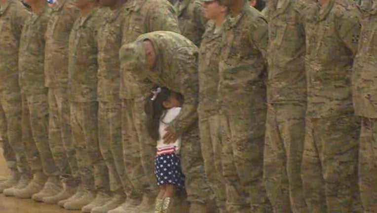 Girl Hugs Soldier Dad-402970
