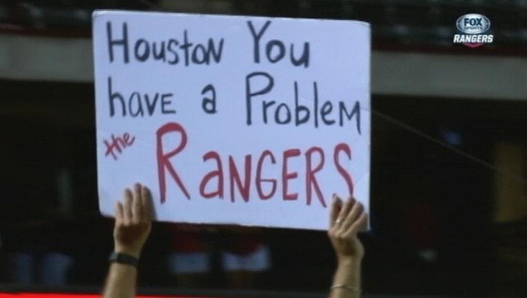 80b28ad3-Rangers Astros Sign_1442458890879.jpg