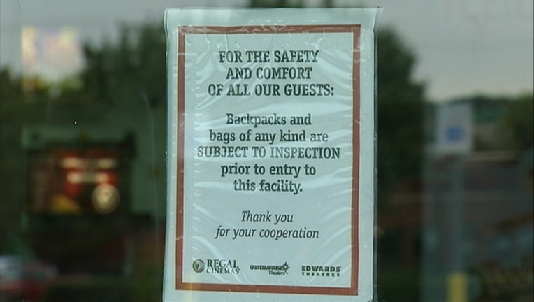 903887af-Movie theater security sign