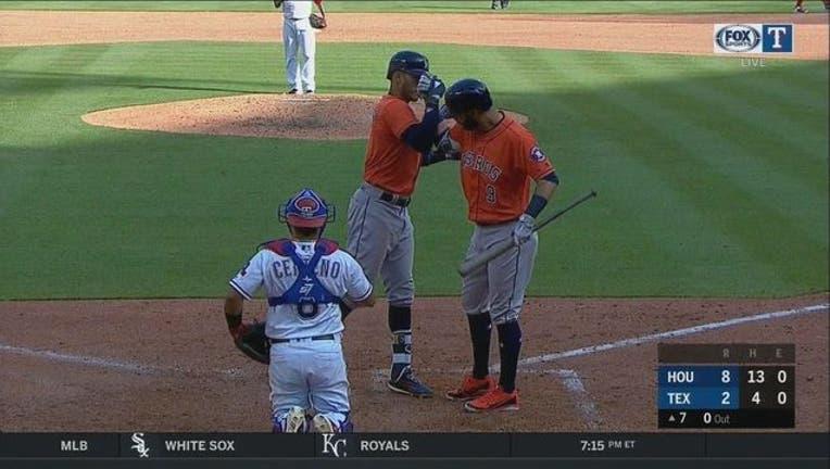 Rangers vs Astros 3-31_1522541713907.jpg