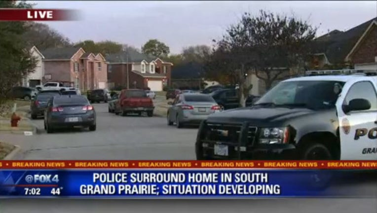 bfcd4700-Grand Prairie Police Surround Home on Autumn Hill near Carrier Parkway_1543078663430.jpg.jpg