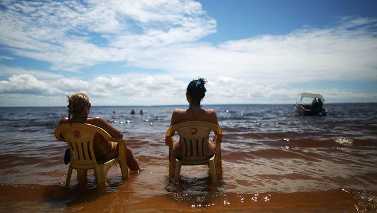 GETTY Stock image of beach, women sunbathing, hot day, hot weather-404023