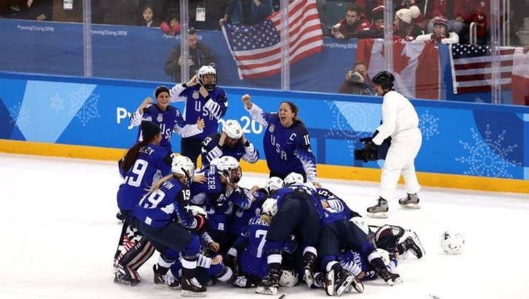 c9279cb9-USA women hockey gold medal getty images