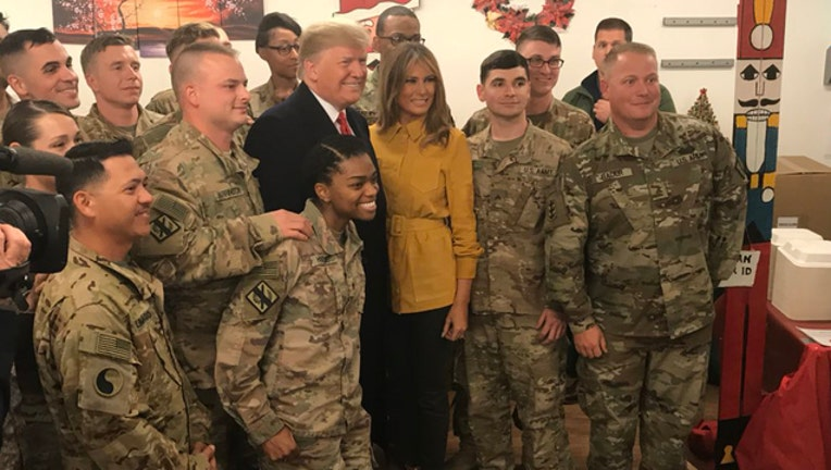 e9db7242-President Trump with troops-401720