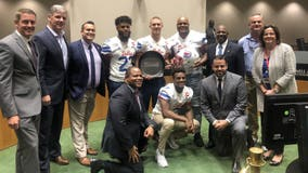 SMU football shows off Iron Skillet at Dallas City Council meeting after defeating TCU