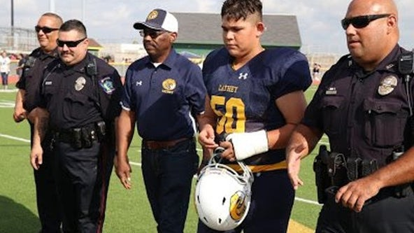 Officers vow to take care of fallen corporal's family, attend son's first football game