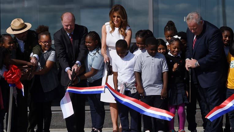 US First Lady Melania Trump participates in the ribbon cutting ceremony with 4th graders from Amidon-Bowen Elementary school during the reopening of the Washington Monument on the National Mallon September 19, 2019 in Washington, DC.