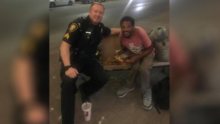 0d765a11-FW officer shares meal with homeless man_1564417073075.jpg.jpg