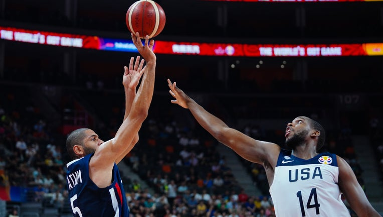 Nicolas Batum #5 of France shoots the ball against Khris Middleton #14 of USA during FIBA World Cup 2019 quarter-final match between the United States and France at Dongguan Basketball Center on September 11, 2019 in Dongguan, Guangdong Province of China. (Photo by VCG/VCG via Getty Images)