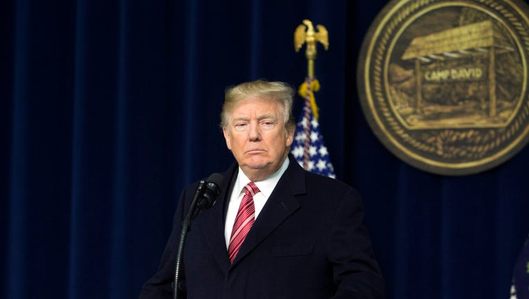 U.S. President Donald Trump speaks to the press after holding meetings at Camp David on January 6, 2018.