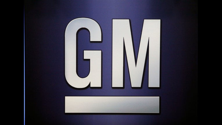 DETROIT, MI-JUNE 6: The General Motors logo is shown on the podium at the company's annual meeting of shareholders June 6, 2017 in Detroit, Michigan. The results of a fight between the company and hedge fund Greenlight Capital, which has proposed to split the automaker's stock and change its board of directors, was to be announced. (Photo by Bill Pugliano/Getty Images)