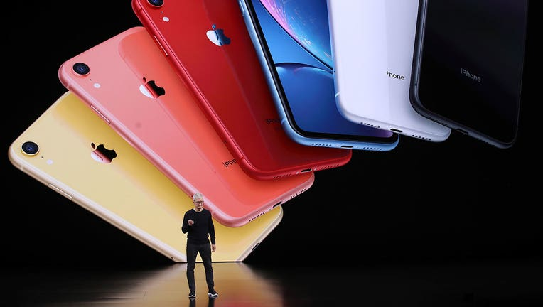 Apple CEO Tim Cook announces the new iPhone 11 as he delivers the keynote address during a special event on September 10, 2019 in the Steve Jobs Theater on Apple's Cupertino, California campus.