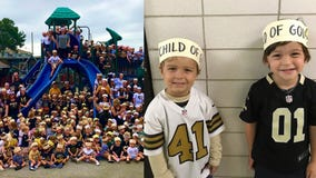 Students wear 'Child of God' headbands in support of New Orleans Saints' Demario Davis