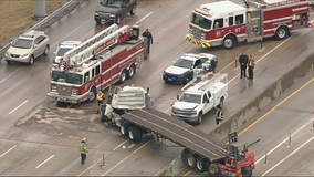 18-wheeler crashes through LBJ median wall