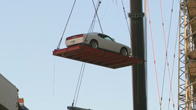 Crews begin removing vehicles from parking garage at Dallas apartments where crane collapsed
