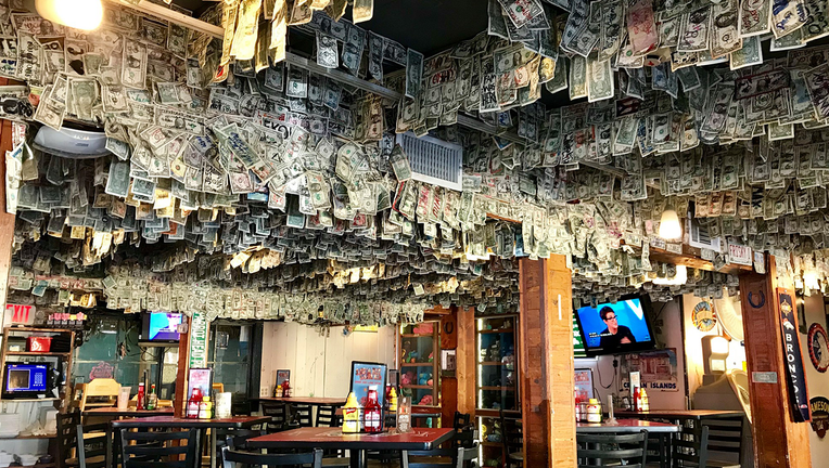 2553eaa5-Money wall at Siesta Key Oyster Bar.