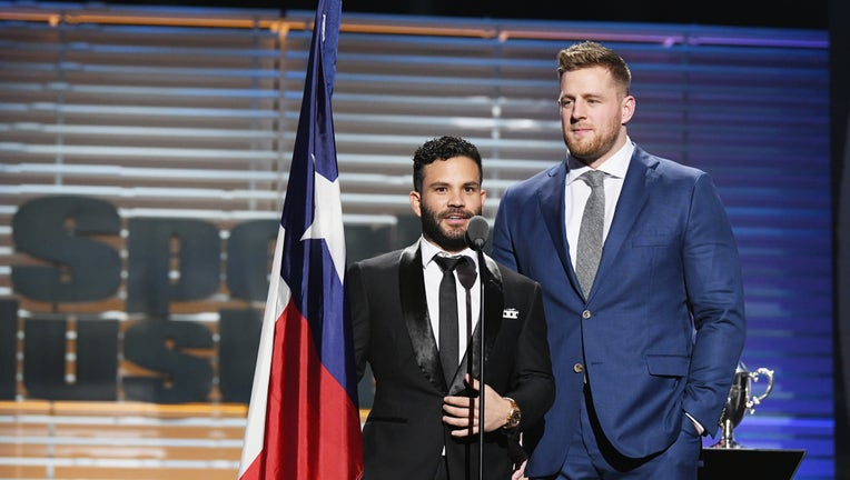 NEW YORK, NY - DECEMBER 05: J.J. Watt (R) and Jose Altuve receive the Sportsperson of the Year Award during SPORTS ILLUSTRATED 2017 Sportsperson of the Year Show on December 5, 2017 at Barclays Center in New York City.