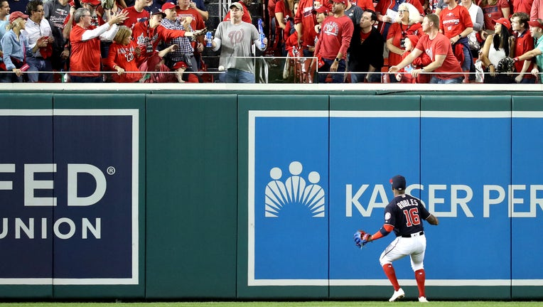 WASHINGTON, DC - OCTOBER 27: Victor Robles #16 of the Washington Nationals watches a two-run home run hit by Yordan Alvarez (not pictured) of the Houston Astros leave the park during the second inning in Game Five of the 2019 World Series at Nationals Park on October 27, 2019 in Washington, DC. (Photo by Rob Carr/Getty Images)