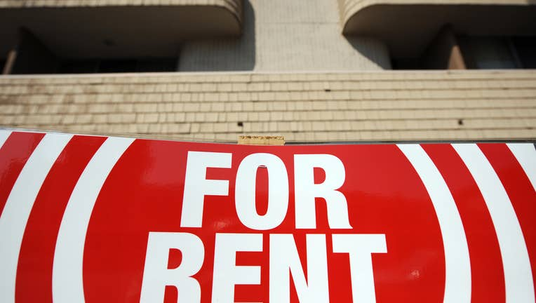A sign for an appartment to rent is seen in Los Angeles (Photo credit should read GABRIEL BOUYS/AFP/Getty Images)