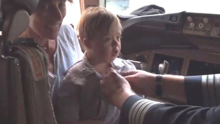 An American Airlines pilot, who retired after 35 years, gave his wings to a child with Down syndrome. (Joe Weis)