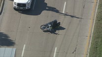 Dallas PD officer hospitalized after being struck while on motorcycle