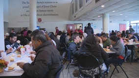 Volunteers serve Thanksgiving meals to veterans, first responders and the homeless