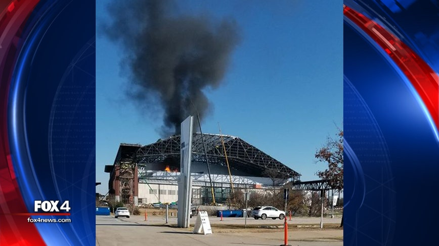 Flames, smoke showing from roof of under construction Globe Life Field