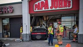 Driver loses control, crashes into Papa John's in Arlington